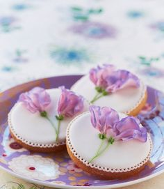 beautiful sweet pea cookie violet on white circle.