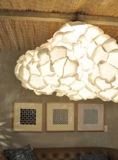 Similar to the Gehry fixture,  the lamp was actually  created by stapling paper plates together.   Now, I am inspired to design something for my place.