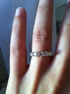 5 stone trellis setting from Whiteflash, semi-custom at 1.0 ctw with slightly graduated stones (.15, .20, .30, .20, .15). All ACA. Finger is size 5.5.