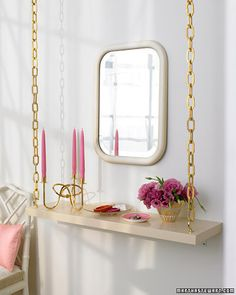 Short on floor space? Create a stylish, space-saving shelf using decorative chains.