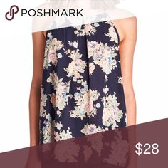 COMING IN STOCK TOMORROW!! Navy floral chiffon tank top! NWT retail 😊 various sizes with be available. So trendy and great for the summer and roll it into the fall season with a cardigan or pair of jeans! Available is S M L, runs true to size. Get it here tomorrow! April Spirit Tops Tank Tops