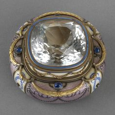 Box. Creator: Ovchinnikov [St Petersburg] (maker). Enamel, gold, topaz, sapphires, diamonds. Dimensions: 4.5 x 6.5 x 6.7 cm. Acquirer: Queen Mary, consort of King George V, King of the United Kingdom (1867-1953). Provenance: Gift to Queen Mary from the Royal Household, 26 May 1928.