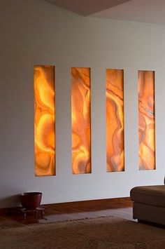 Backlit Honey Onyx Feature wall. Visit globalgranite.com for your natural stone needs.