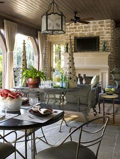 outdoor fireplace, beaded board ceiling, lantern--what's not to love!