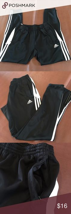 """adidas Women's Condivo Warm Up Training Pant Super nice condition! You can't go wrong with the classic black and white three-stripe look. Bottom leg zips. Embroidered adidas brandmark. Zip pockets. Women's-specific cut, anatomically shaped female fit. CLIMACOOL provides heat and moisture management through ventilation. 29"""" inseam, 5"""" across the ankle measured flat. Fit true to size. adidas Pants Track Pants & Joggers"""