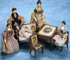A Family of Grodnertal Wooden Dolls and Furnishings.