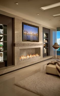 Beautiful room with a linear fireplace. Contemporary Residence Boca Raton, Florida - contemporary - Living Room - Miami - Interiors by Steven G Fireplace Design, Linear Fireplace, Tv Fireplace, Bedroom With Fireplace, Granite Fireplace, Wall Mounted Fireplace, Ethanol Fireplace, Fireplace Ideas, Luxurious Bedrooms