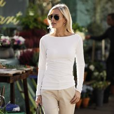 A fitted T-shirt that hits at the hip is a great way to casually show off our figure type... because most of us have broad shoulders (like the model), stay away from shoulder pads - if you purchase a top with them, take them out so you don't look like a line-backer.
