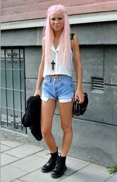 pale pink dyed hair, rolled ripped denim shorts, doc martens & sheer white sleeveless top.
