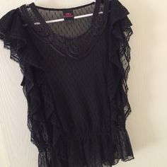 Black Sheer Bebe Blouse Gorgeous blouse, sheer with dotted pattern. Gorgeous ruffling down both sides. bebe Tops Blouses