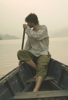 She glanced at him from time to time curiously watching him paddle the boat. Stop looking at him Gale, its weird, she thinks to herself but she looks one more time to find him looking at her