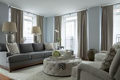 The Elegant Abode Park Ave apartment Ethan Allen gray sectional, tufted ottoman RH rug, chevron pillows, zebra throw