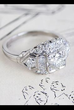 Gorgeous vintage-style engagement ring: Erica Weiner Tiered Diamond and Platinum Engagement Ring, available at ericaweiner.com