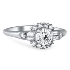 A bright center diamond is showcased in this Art Deco ring. Baguette and single cut diamond accents add glamour to this incredible engagement ring (approx. 0.91 ct. tw.).