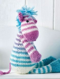 Free Knitting Pattern for Zac the Zebra - This zebra toy softie was designed by Lucinda Ganderton and can easily be adapted to be a horse. Pattern bundle also includes Sid the Snake and Dolly the Sausage Dog by Lynne RoweSusie Johns. The file needs to be unzipped after download.