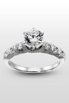 Elise - A detailed, accented engagement ring with round cut Diamond Simulant accents.