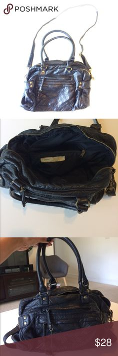 Urban Outfitters Black Purse Urban Outfitters Black Purse; Kimchi Blue brand; faux leather looks and feels real. Perfect condition. Handles or cross body strap. Pockets inside and out. Super versatile and goes with everything! Urban Outfitters Bags