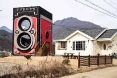 The two story model camera was build by the father of the family, a former air-force helicopter pilot with a passion for cameras.
