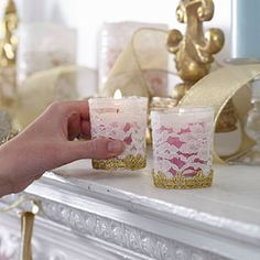 Make votive holders special  Wrap plain glass votive holders with lace; glue in place. Add gold trim along the bottom.