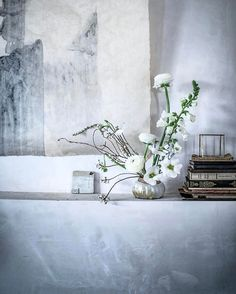 A wabi-sabi corner of our plaster mantle back home with @petalinefloral ikebana inspired florals, hand painted Japanese paper, a little handmade tile from @rikumo, a candle holder from @alderandco, and antique books in languages I can't read. Long before I started my annual pilgrimages to Japan, I was fundamentally inspired by the idea of perfect imperfection. My core philosophy was wabi-sabi before I really had the words for it. When I first started my blog, it was something I talked about…