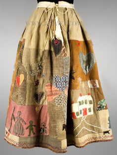 Assembled from early to mid 19th C. scraps of homespun wool, prints, yarn and more, all hand sewn, this Story Skirt is reminiscent of the wonderful African American Quilts made by Harriet Powers in the late 19th Century.