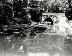 "Caption: ""Tunnel tug 'Tring' leaving Islington tunnel with barges on the Regent's Canal"" Old London, London City, Regents Canal, London History, London Pictures, Canal Boat, Historical Pictures, Cityscapes, Caption"