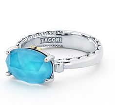 I heart this ring from TACORI! Style no: SR13905 This unique oval shaped Barbados blue ring is absolutely breathtaking! A Clear Quartz layered over Neolite Turquoise center stone is nestled within a crescent engraved .925 silver band to create a tropical artwork.