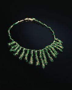 The seed beads that hang loosely from several thin crocheted chains give this necklace a sense of motion and elegance. It is perfect for wearing with a low v-neck collar and dresses up any outfit, day or night.