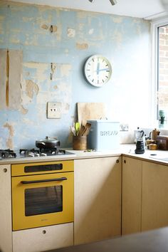 Birch Plywood kitchen and a yellow Smeg by Stonermakes