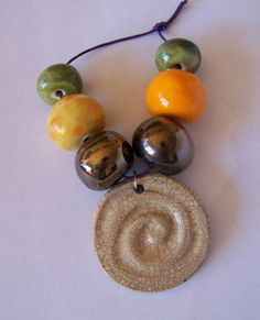 Ceramic bead set raku pendant copper lustre by EarthbutterStudio, $15.00