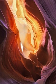 Antelope Canyon by Long Nguyen.  Natural light captured in a long exposure on a tripod.  As the light changes (the sun travels across the sky), different areas of the cave are illuminated, & various color tones are recorded.  Lovely!