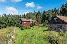 Small old farm outside Ludvika in Sweden - I love the roundpole fence around the yard.