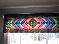 French braid window covering quilt looks like stained glass!