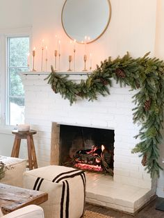 holiday Winter house - Holiday Home Tour: This Dreamy Space Proves That White Is Actually the Most Festive Color Christmas Fireplace, Cozy Christmas, Modern Christmas, Simple Christmas, Christmas Holidays, Christmas Crafts, Christmas Nails, Modern Holiday Decor, Minimal Christmas
