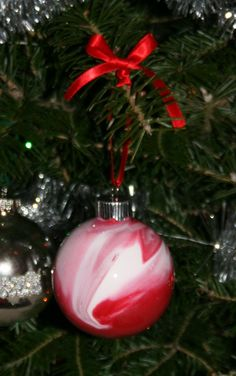 Fun Easy Christmas gift for kids to make for teachers, grandparents, etc.      Tools: Clear plastic ornaments, craft paint (paint should be the cheap runny kind), some kids and lots of paper towels!      To do: Have the kids squirt two different colors of paint into an ornament and swirl around until the entire inside is coated. (More that two colors and the paint goes a muddy color.)Drain the extra paint out and leave to dry over night. Add the top and some ribbon.   Ta Da!
