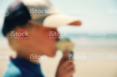 Child Eating Ice Cream at Beach, Completely Defocussed royalty-free stock photo