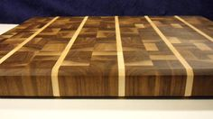 Beautiful plaid cutting board end grain made of walnut and hard maple. The end grain is easier on your knives. It is sealed with bees wax and food grade mineral oil. Hand wash and dry and reapply mineral oil as needed. Size 18.5 inches by 14.5 inches by 1.5 inches thick. This is