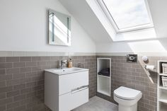 This loft bathroom in south London is both calming and masculine. Part of a real loft conversion in south-west London, clever storage solutions has made this small space functional. For more loft bathroom ideas go to the Simply loft website. Garage Attic, Attic House, Attic Playroom, Attic Loft, Attic Rooms, Attic Office, Attic Stairs, Attic Shower, Small Attic Bathroom