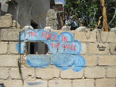 The Hole in the Wall.  It's a place on the Grass Roots United compound in Port Au Prince, Haiti where you can purchase various refreshments from local Haitian merchants.