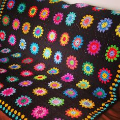 This lovely retro vintage style blanket is constructed using 64 squares with floral or sunburst centers using 3 different colors all set in gorgeous