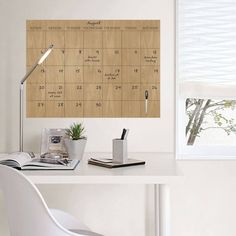 Never miss an important date with this chic faux hardwood dry-erase calendar. | 20 Useful Things Every Unorganized Person Needs
