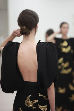 Gorgeous back, balance by balloon sleeves and shoulder pads.