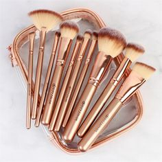 This sleek set of 10 makeup brushes contains everything you need for a complete full-face look.Featuring durable rose gold ferrules, it includes a mix of synthetic fibers for ultimate softness and blendable application. Makeup Brush Storage, Makeup Brush Cleaner, Makeup Brush Holders, Makeup Brush Set, Eye Makeup Brushes, How To Clean Makeup Brushes, Makeup Tools, Rose Gold Brush Set, Make Up Gold