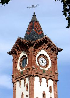Clock tower in Barcelona at Gran Via 247 - photo by Arnim Schulz, via Flickr