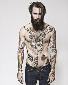 Bearded shirtless man with great tattoos is fine by me