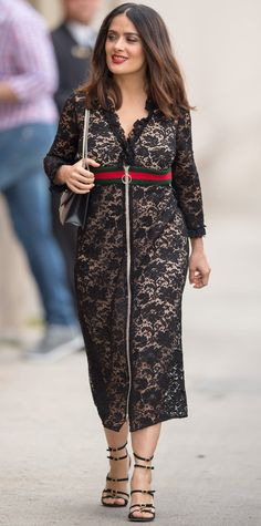 Salma Hayek was picture perfect while out and about on the streets of Los Angeles. She wore a black zip-up lace Gucci dress (identifiable by its sporty green-and-red striped band across the bodice), complete with a structured shoulder bag and strapy buckled heels.