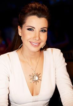 Nancy Ajram beautiful makeup, star pendant & Elie Saab dress @ Arab Idol
