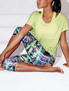 The Free-Flow fabric of these colorful capri leggings are perfect for hot yoga poses, Pilates, and even swimming. SHOP @ FitnessApparelExpress.com