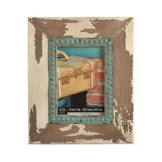 <div>Vintage-looking frame with its peeling paint and distressed iron fillet is perfect for disp...