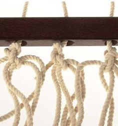 The 20 cords need to be threaded through the drilled holes of the hardwood spreader bars. (Clicktoenlarge)